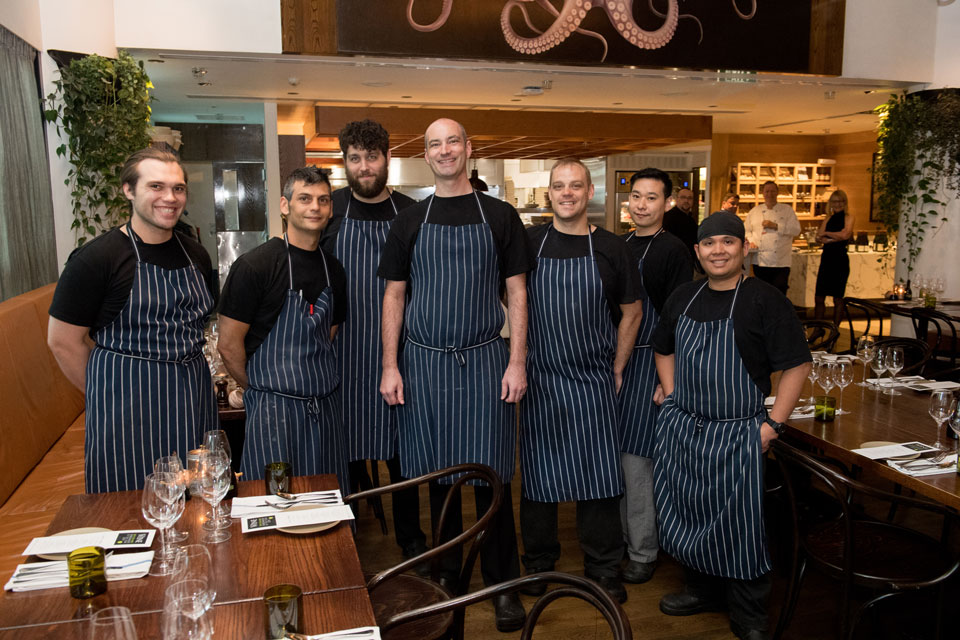 Chef Vaughan Kay (middle) with his team