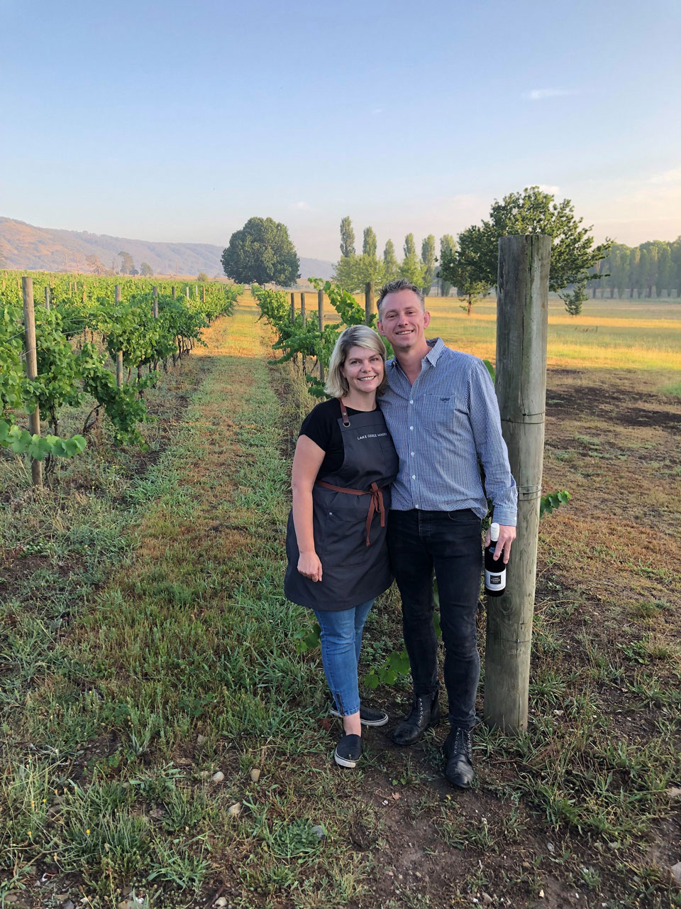 Sarah and Anthony McDougall in the vines of Lake  George Winery.